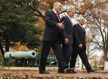 President Bush, center, walks with Israeli Prime Minister Ehud Olmert, left, and Palestinian President Mahmoud Abbas