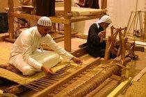 Carpet weavers at work at the Janadriyah festival (photo: Hanna Labonté)