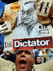 Ägyptischer Demonstrant mit Karikatur von Präsident Hosni Mubarak; Foto: AP