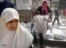 Women in Gaza City receiving food supplies from the UNRWA (photo: AP)