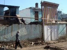 Zerstörungen nach den Unruhen in Osch; Foto: DW