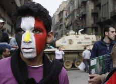 Junge demonstriert gegen das Mubarak-Regime in Kairo; Foto: AP