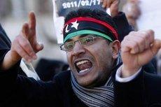Ein junger Demonstrant bei einer Kundgebung gegen Gaddafi; Foto: AP/dapd