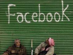 Facebook-Graffity auf einem Laden in Kairo; Foto: dpa