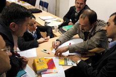 Türkische Imame nehmen am Deutschunterricht teil; Foto: dpa