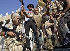 Rebellen in Tripolis; Foto: dapd