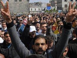 People demonstrating against Bashar al-Assad (photo: AP)