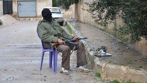 Ein bewaffneter Rebell in Homs. Foto:AP/dapd
