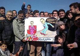 Demonstranten in Syrien halten Transparent gegen Assad und Putin hoch; Foto: AP