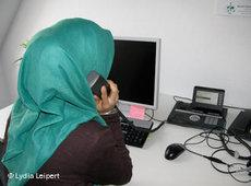 A young Muslim volunteer working on the Muslim pastoral care hotline (photo: Lydia Leipert)