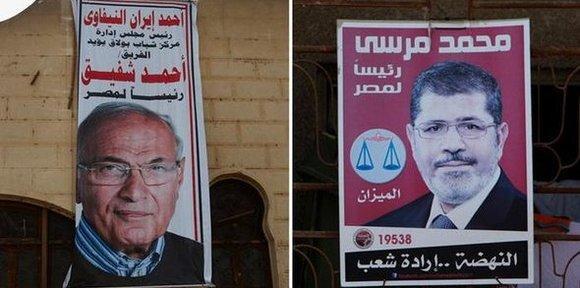 Wahlplakate Ahmed Shafiks (links) und Mohamed Mursis (rechts); Foto: dapd/DW-Montage