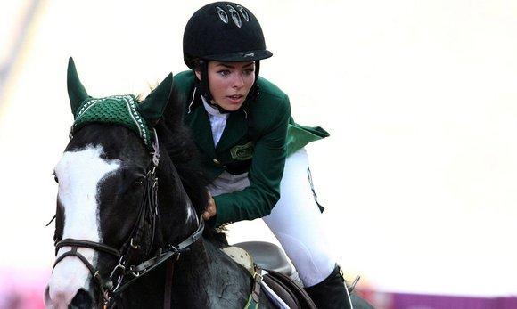 Dalma Rushdi Malhas of Saudi Arabia rides Flash Top Hat at the Singapore 2010 Youth Olympic Games (photo: picture-alliance/dpa)