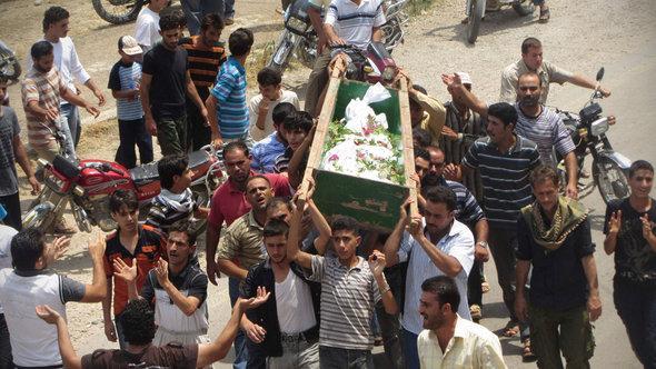Beerdigung eines Regimegegners in Hula; Foto: Reuters