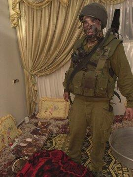 An Israeli soldier on duty in a Palestinian home (photo © Breaking the Silence)