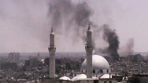 Rauchschawaden über der zentralsyrischen Stadt Homs; Foto: Reuters