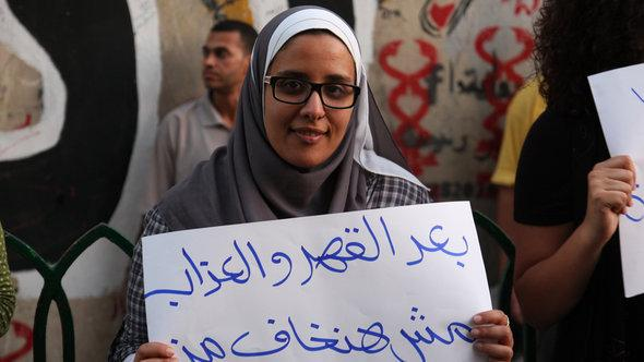 A woman in Cairo demonstrating against sexual harassment (photo: Mohammed Al Bedawi)