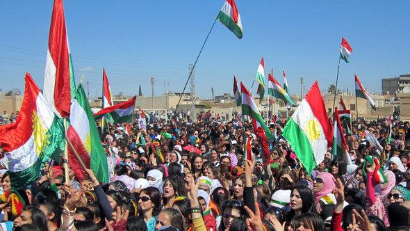 Syrian Kurds wave the Kurdish flag as they rally against the Syrian regime and to mark Noruz spring festivities in the northern city of Qamishli on March 21, 2012 (photo: AFP/Getty Images)
