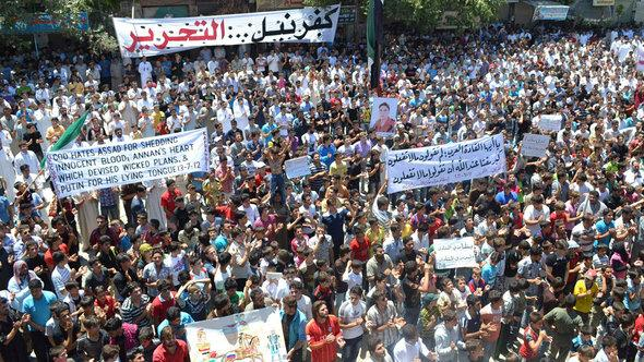Anti-Assad demonstration in Kafranbel, close to Idlib (photo: Reuters/Shaam News Network)