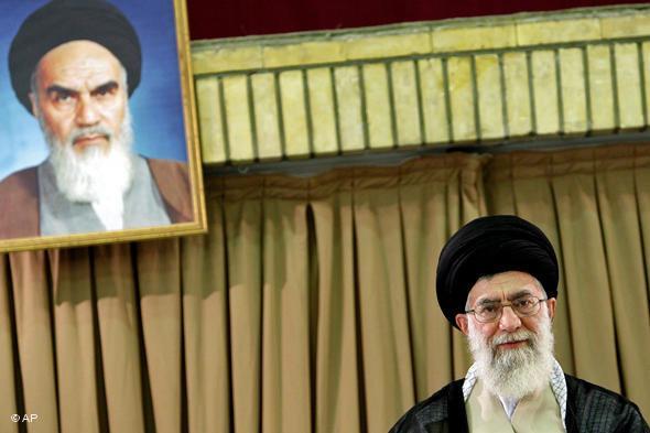 Iran's Ayatollah Ali Khamenei sits beneath a portrait of Ayatollah Khomeini (photo: AP)