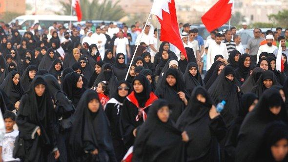 Anti-government protesters are seen marching on a highway leading to the village of Karzakan during a rally held by Bahrain's main opposition party Al Wefaq south of Manama, May 11, 2012. (photo: Reuters/Hamad Mohammed)