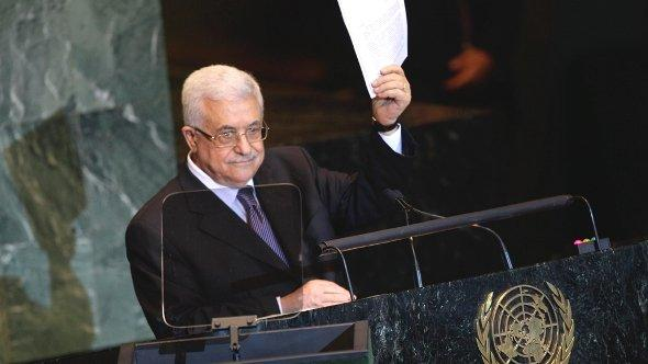 Palestinian President Mahmoud Abbas holds a letter requesting recognition of Palestine as a state as he addresses the 66th session of the United Nations General Assembly, Friday, Sept. 23, 2011 at UN Headquarters (photo: Reuters)