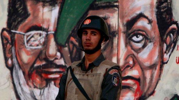 Graffiti Mubaraks und Mursis in Kairo; Foto: Reuters