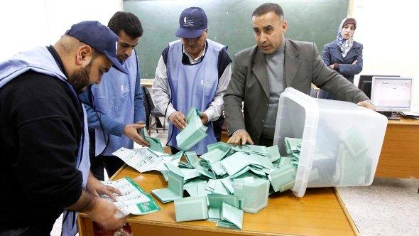 Jordanian election officials empty ballot boxes to begin counting th