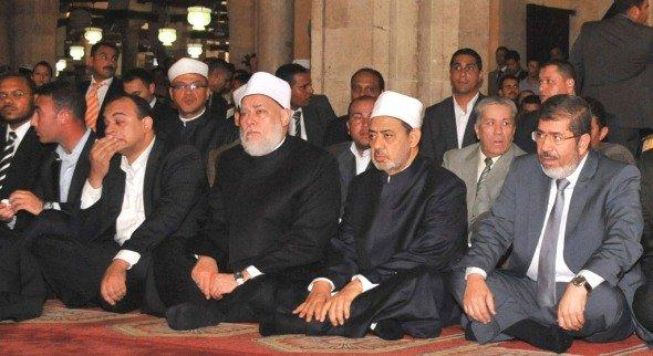 Egypt's president-elect Mohamed Morsi (R) attends Friday prayer at al-Azhar mosque in the old quarter of Cairo June 29, 2012, together with Ahmed Muhammad Ahmed el-Tayeb, the current Grand Imam of Al-Azhar, sitting to the left of Morsi (photo: Reuters)