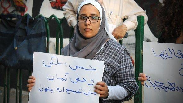 A photo of Nihal Saad Zaghloul, an Egyptians activist and co-founder of the 'Imprint Movement', holding a sign saying 'My body is mine and my right also. Never let anyone insult others.' (photo: courtesy of Nihal Saad Zaghloul)