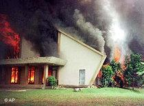Kare Catholic Church in Indonesia burns after it was ransacked and set on fire by Muslim mobs (photo: AP)