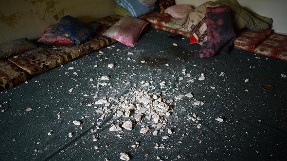 Geschosseinschläge in einer Wohnung in Aleppo; Foto: AFP/Getty Images