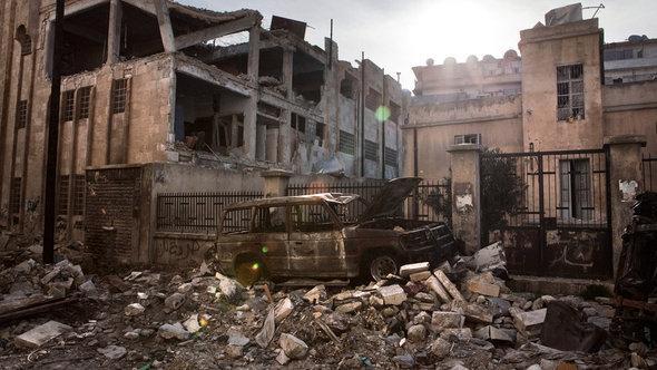 Zerstörte Häuser in der umkämpften Stadt Aleppo; Foto: picture alliance/dpa