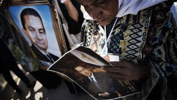 Anhänger Mubaraks in Kairo; Foto: GIANLUIGI GUERCIA/AFP/Getty Images