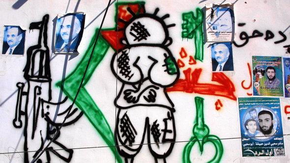 Graffiti an einer Mauer des palästinensischen Flüchtlingslagers Balata; Foto: © Getty Images