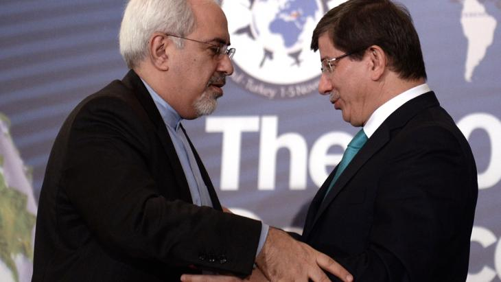 Iran's new Foreign Minister Mohammad Javad Zarif, left, and his Turkish counterpart Ahmet Davutoglu greet each other during a forum in Istanbul, Turkey, Friday, Nov. 1, 2013 (photo: AP)