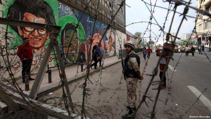 Wand mit den Gesichtern von Männern, die bei den Protesten vor zwei Jahren starben; Foto: picture-alliance/dpa
