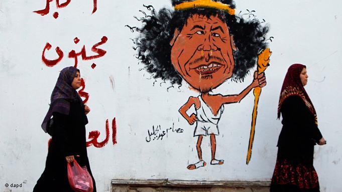 Gaddafi als verrücktester Mann der Welt: Wandmalerei in Tripolis; Foto: EPA/Getty Images