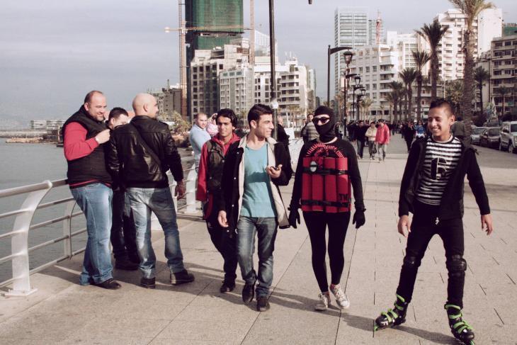 Artist Rima Najdi walks along Beirut's Corniche wearing a fake explosive belt on 12 January 2014 (photo: Maria Kassab)