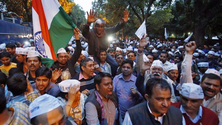 Supporters of the AAP shout slogans during a protest outside the headquarters of the BJP in New Delhi on 5 March 2014 (photo: Reuters/UNI)