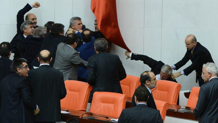 Members of parliament from the ruling AKP and the CHP involved in a scuffle during a debate on a justice bill, 15 February 2014 (photo: Reuters)