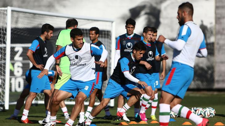 Iran's players attend a training session at the CT Joaquim Grava training ground in Sao Paulo at the 2014 FIFA World Cup football tournament on 13 June 2014 (photo: BEHROUZ MEHRI/AFP/Getty Images)