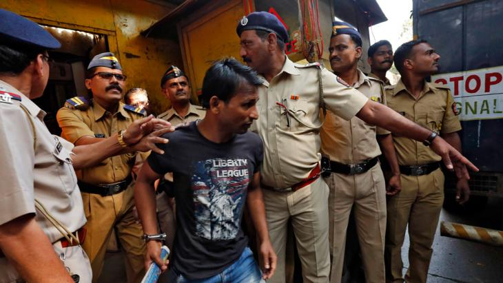 March 2014: Police escort one of four men convicted of the gang-rape of a photojournalist in Mumbai in 2013. Photo: REUTERS/Mansi Thapliyal
