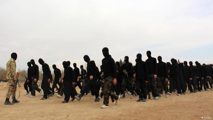 Recruits being put through their paces in an extremist training camp (photo: Reuters)