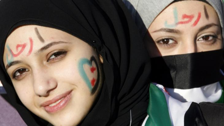 Young woman taking part in a demonstration against the Assad regime in Aleppo on 6 October 2012 (photo: Rawan Issa)