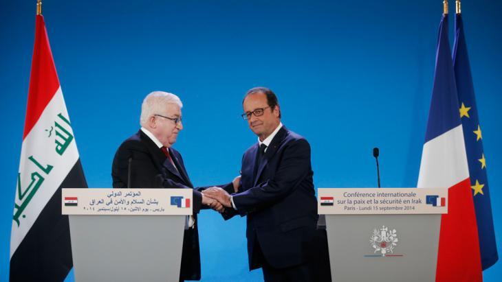 Iraks Präsident Fuad Masum und Frankreichs Präsident Francois Hollande; Foto: Reuters/Christian Hartmann