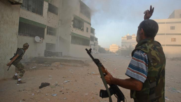 Libysche Rebellen in Abou Selim; Foto: picture-alliance/dpa/C. Petit Tesson