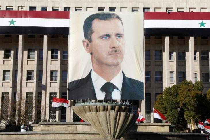 Assad-Porträt an einem Regierungsgebäude in der Innenstadt von Damaskus; Foto: Reuters