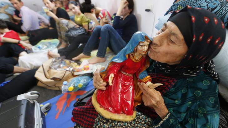 Geflohene irakische Christin aus Mossul; Foto: AFP/Getty Images