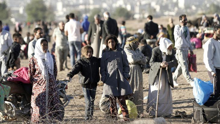 Massenflucht aus Syrien in die Türkei: syrische Flüchtlinge im türkischen Sanliurfa; Foto: picture-alliance/dpa/U. Yunus Tosun