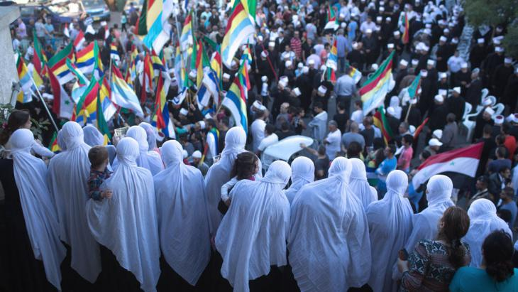 Members of the Druze community in the Golan Heights during a demonstration in support of Syrian President Bashar al-Assad's army, Majdal Shams, 15 June 2015 (photo: MENAHEM KAHANA/AFP/Getty Images)